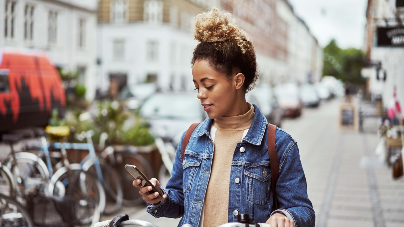 Woman looking at new Unily widgets on iPhone