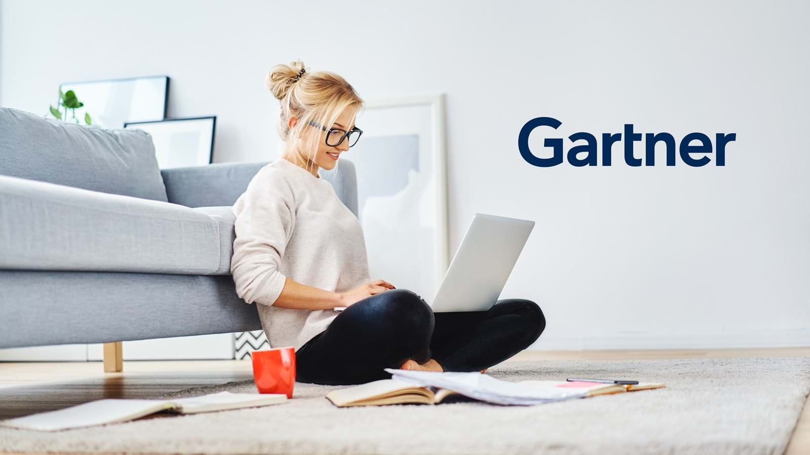 Employee reading Gartner's Market Guide on her laptop