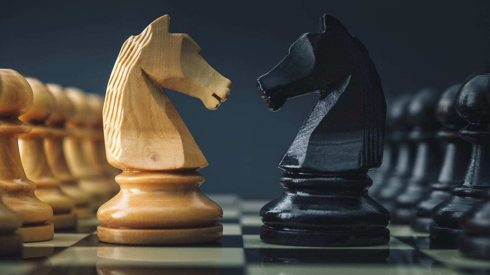 Chess pieces facing off in preparation for debate