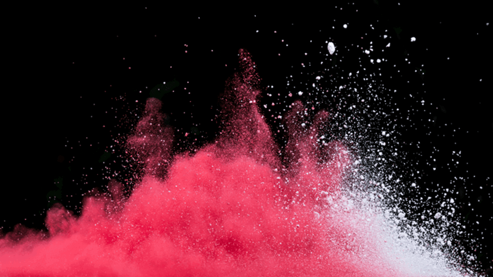 Red and white powder being thrown up into the air representing changing the enterprise